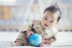 Asian baby in soldier uniform