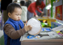 Asian baby son in a toy shop Royalty Free Stock Image