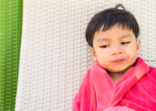 Asian Baby swimmer on a beach chair Stock Photos