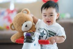 Asian baby and teddy bear stock photography