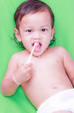 Asian baby and toothbrush Royalty Free Stock Image