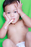 Asian baby and toothbrush Royalty Free Stock Photo