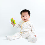Asian baby with toy Royalty Free Stock Image