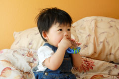 Asian Baby With Toy Royalty Free Stock Photos