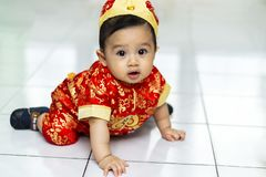 Asian baby using cheongsam dress for chinese new year royalty free stock photos