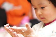 Asian baby washing hands Stock Photo