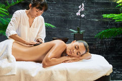 Asian back massage therapy spa hot stone. Relaxation Royalty Free Stock Photography