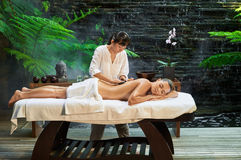 Asian back massage therapy spa hot stone. Relaxation Royalty Free Stock Images