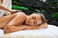 Asian back massage therapy spa hot stone. Relaxation Royalty Free Stock Image