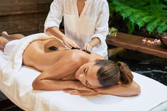Asian back massage therapy spa hot stone. Relaxation Royalty Free Stock Photos