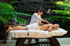 Asian back massage therapy spa hot stone. Relaxation Stock Photos