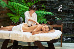 Asian back massage therapy spa hot stone. Relaxation Stock Photography