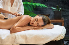 Asian back massage therapy spa hot stone. Relaxation Stock Images