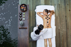 Asian back massage therapy spa hot stone Stock Images