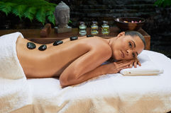Asian back massage therapy spa hot stone Royalty Free Stock Photos
