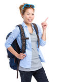 Asian backpacker with finger pointing up. Isolated on white Royalty Free Stock Images