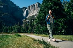 Asian backpacker walking on path wearing sandals royalty free stock image