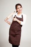 Asian Baker woman  in apron point to wooden rolling pin Stock Images