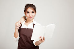 Asian Baker woman  in apron  with wooden rolling pin and cook bo Stock Image