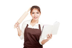Asian Baker woman  in apron  with wooden rolling pin and cook bo Royalty Free Stock Photography