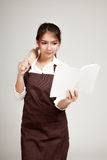 Asian Baker woman  in apron  with wooden rolling pin and cook book Royalty Free Stock Images