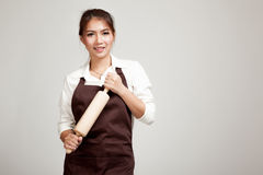 Asian Baker woman  in apron  with wooden rolling pin Royalty Free Stock Photo