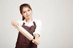 Asian Baker woman  in apron  with wooden rolling pin Stock Photos
