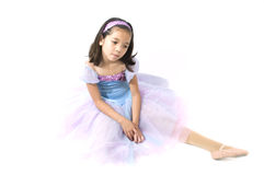 Asian Ballerina Performing Ballet Move. Isolated Against White Background Stock Photos