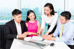 Asian banker team counseling couple in office stock photos