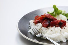 Asian barbecue pork on a bed of steamed rice. Stock Image