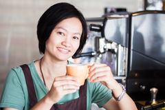 Asian barista enjoy her coffee Royalty Free Stock Photo
