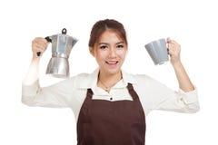Asian barista girl with coffee Moka pot and cup Royalty Free Stock Photos