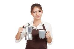 Asian barista girl with coffee Moka pot and cup Stock Photos
