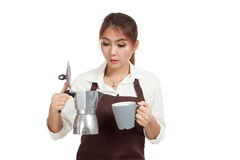 Asian barista girl with coffee Moka pot and cup Royalty Free Stock Photo