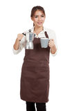 Asian barista girl with coffee Moka pot and cup Royalty Free Stock Images