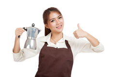 Asian barista girl thumbs up with coffee Moka pot. Isolated on white background royalty free stock photos