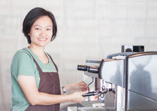 Asian barista smiling and making cup of coffee Stock Image