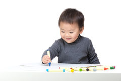 Asian bay boy concentrate on drawing. On white Royalty Free Stock Photography