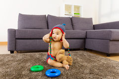 Asian bay play toy. At home Royalty Free Stock Image