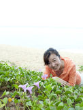 Asian beatiful girl playing morning glory Stock Photo