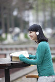 Asian beatiful student reading book in campus Royalty Free Stock Image
