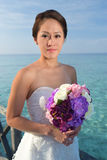 Asian beautiful bride holding her flowers Stock Photo