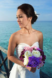 Asian beautiful bride holding her flowers Stock Photos