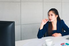 Asian beautiful business woman have worry in her thinking stock image