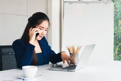 Asian beautiful business woman use mobile. royalty free stock photography