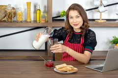 Asian beautiful business women pouring milk royalty free stock photos