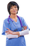 Asian beautiful female doctor with crossed arms looking at camer Stock Photos