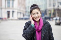 Asian beautiful girl calling by phone Royalty Free Stock Photos