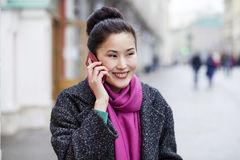 Asian beautiful girl calling by phone Royalty Free Stock Image