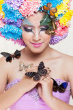 Asian Beautiful Girl With colorful make up with fresh Chrysanthemum  Flowers and Butterfly Stock Photos